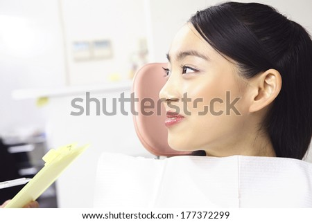 Japanese women undergoing dental checkup