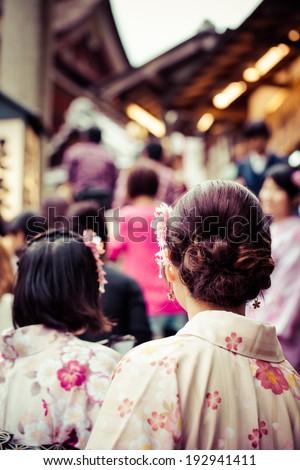 Japanese women wear a traditional dress called Kimono for Sakura viewing at Kiyomizu temple in Kyoto - stock photo