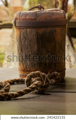 Japanese wooden sinker with rope - stock photo
