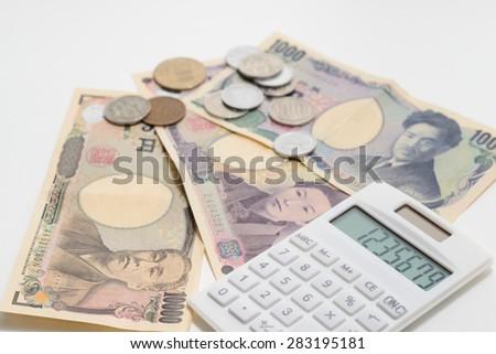 Japanese Yen and Calculator - stock photo