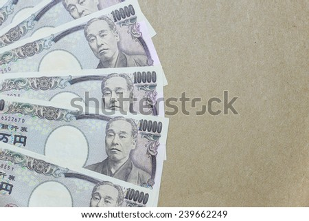japanese yen on brown paper background - stock photo