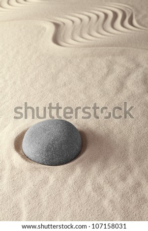 Japanese zen garden lines and stones form meditation pattern relaxation and tao buddhism - stock photo