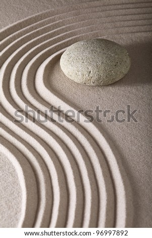 japanese zen garden sand and rocks or stones from calm linear pattern leading to spiritual balance - stock photo