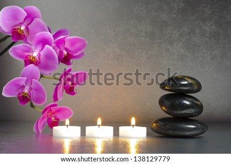 Japanese zen garden with candle lights and stones - stock photo