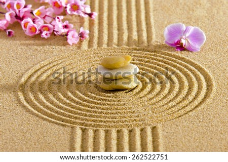 Japanese ZEN garden with feng shui and stacked stones in sand - stock photo