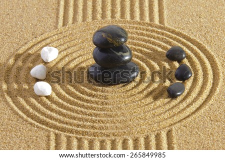 Japanese ZEN garden with Feng shui in sand with stones of yin yang - stock photo