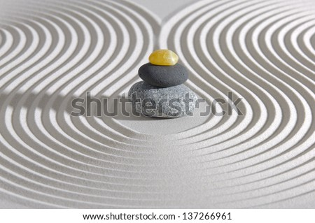 Japanese ZEN garden with stacked stones in sand - stock photo