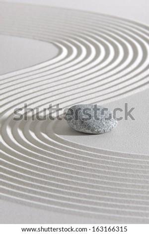 Japanese ZEN garden with stone in raked white sand - stock photo