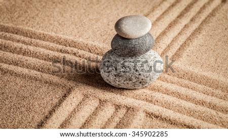 Japanese Zen stone garden - relaxation, meditation, simplicity and balance concept  - panorama of pebbles and raked sand tranquil calm scene - stock photo