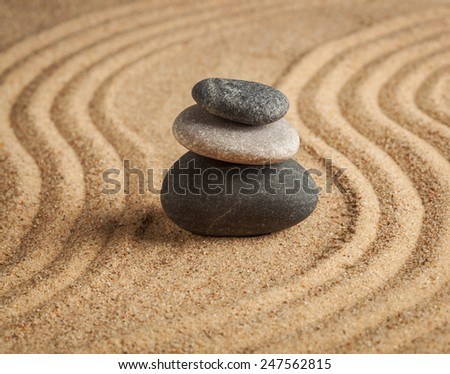 Japanese Zen stone garden - relaxation, meditation, simplicity and balance concept  - pebbles and raked sand tranquil calm scene