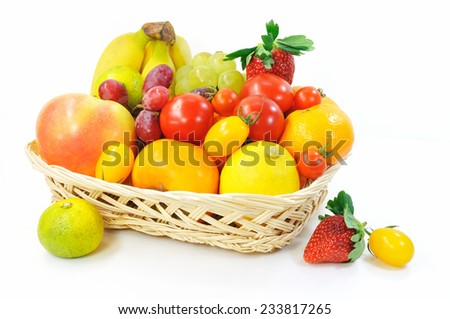 Japaneses fruit and tomatoes in a basket.  - stock photo