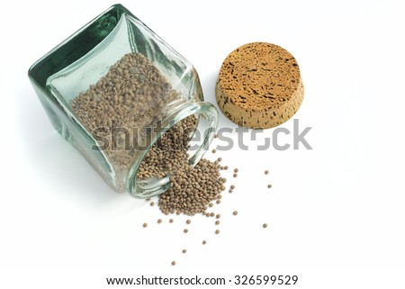 jar cooked full of lentils over white background