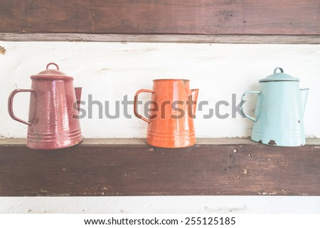 Jar decoration on wall - vintage film effect style - stock photo