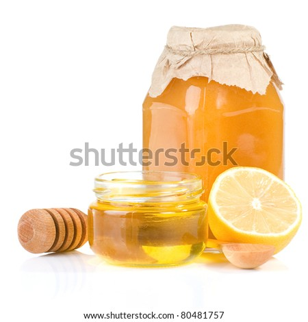 jar full of honey and lemon isolated on white background