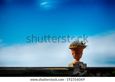 Jar in front of blue sky - stock photo
