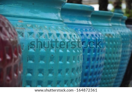 jar in many color blue green red brown