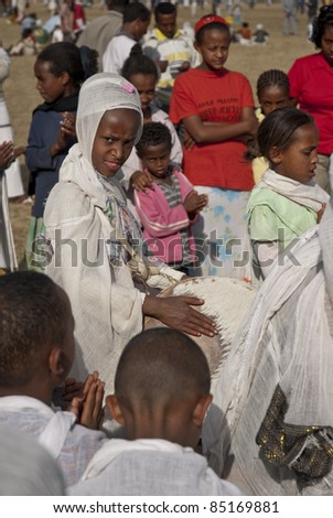 JAR MADA, ADDIS ABABA - JAN 18: Christian Orthodox devotees at the Timket Festival.  January 18, 2009 in Jar Mada, Addis Ababa, Ethiopia - stock photo