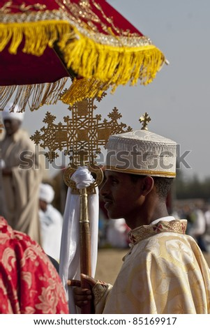 JAR MADA, ADDIS ABABA - JAN 18: Christian Orthodox devotees holding the Lalibela Cross at the Timket Festival.  January 18, 2009 in Jar Mada, Addis Ababa, Ethiopia - stock photo