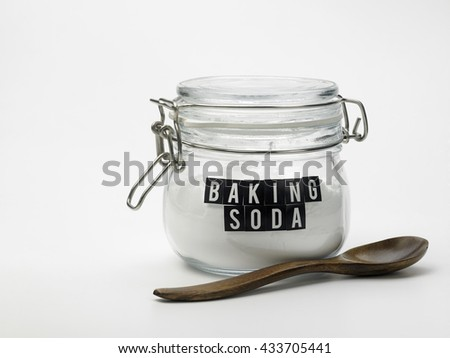 jar of baking soda on the white background - stock photo