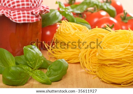 Jar of bolognaise sauce with pasta, tomatoes and basil herbs - stock photo