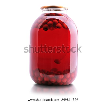 Jar of cherry compote on a white background - stock photo