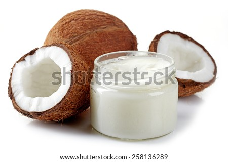jar of coconut oil and fresh coconuts isolated on white