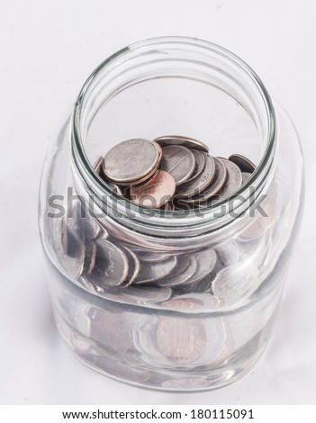 jar of coins - stock photo
