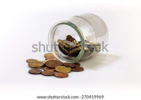 Jar of coins isolated on white, lying on a floor.