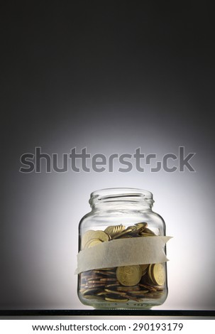 Jar of coins with label for your own text