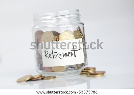 """Jar of coins with """"Retirement"""" label - stock photo"""