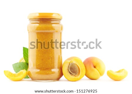 Jar of fresh apricot jam with apricots on white - stock photo