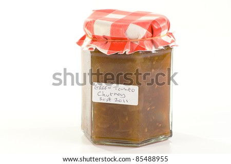 jar of home made green tomato chutney isolated on a white background - stock photo