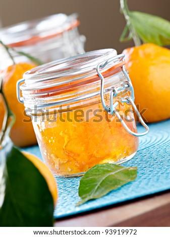 jar of homemade orange jam closeup - stock photo
