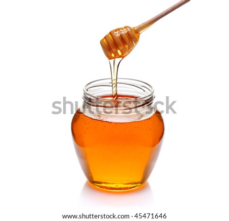 Jar of honey with wooden drizzler isolated on white background - stock photo