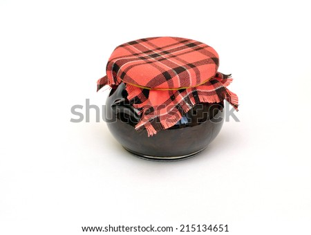 jar of jam tied with a checkered headscarf isolated on a white background - stock photo