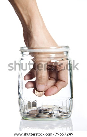 Jar of Money with hand picking up Isolated on a White Background - stock photo
