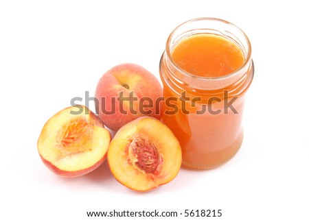 jar of peach jam and some fresh fruits isolated on white - stock photo