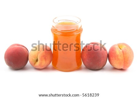 jar of peach jam and some fresh fruits isolated on white