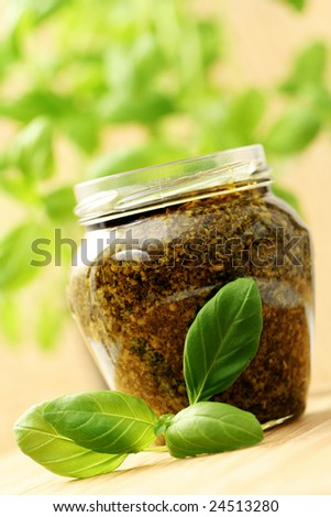 jar of pesto sauce with fresh basil - food and drink