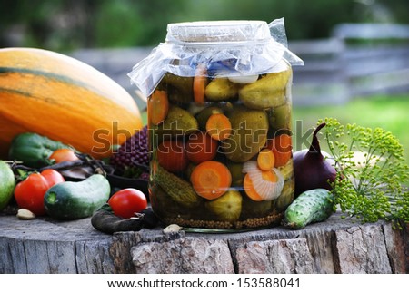 jar of pickles with veggies - stock photo