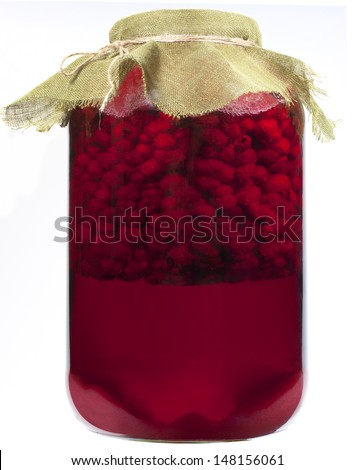 jar of raspberry syrup isolated on white - stock photo