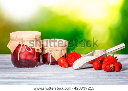 jar strawberry jam blur nature wooden table - stock photo