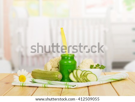 Jar vegetable puree, cauliflower, squash and cotton cloth on the background of the kitchen. - stock photo