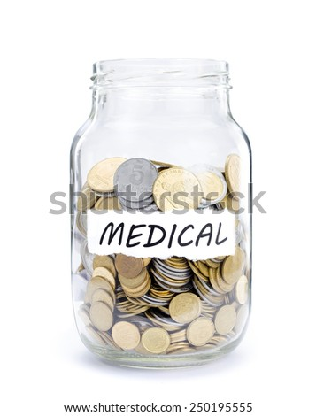 Jar with coins on Medical, money isolated on white. - stock photo