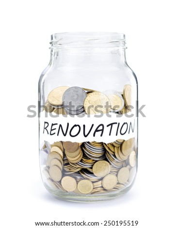 Jar with coins on Renovation, money isolated on white. - stock photo