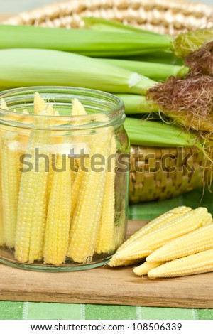 Jar with corn preparing for preserving. - stock photo