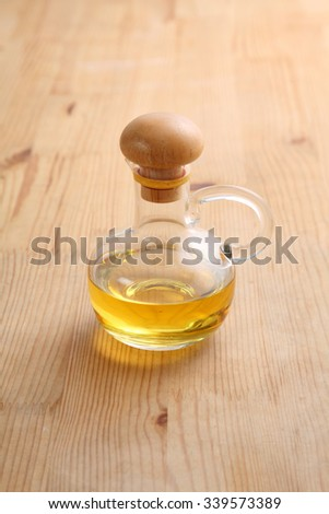 jar with oil on the wooden background - stock photo