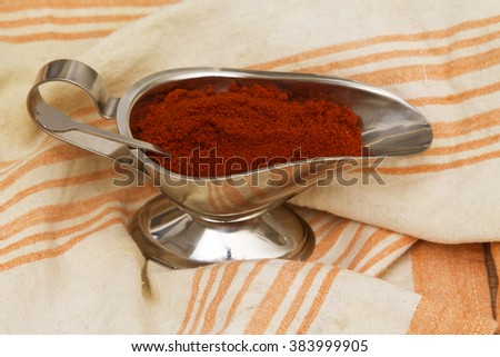 jar with paprika on napkin