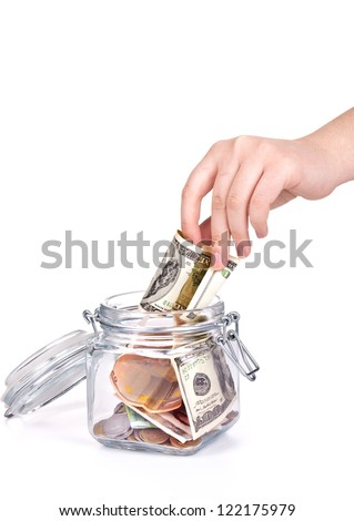 jar with the money and hand on white - stock photo