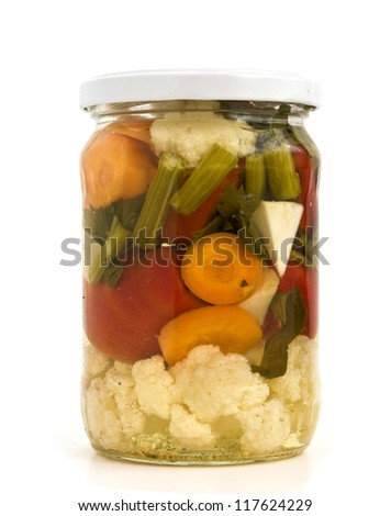 Jar with vegetables isolated on white background